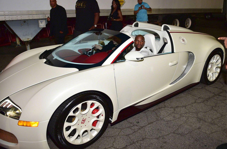 Floyd Mayweather In A White Bugatti Veyron