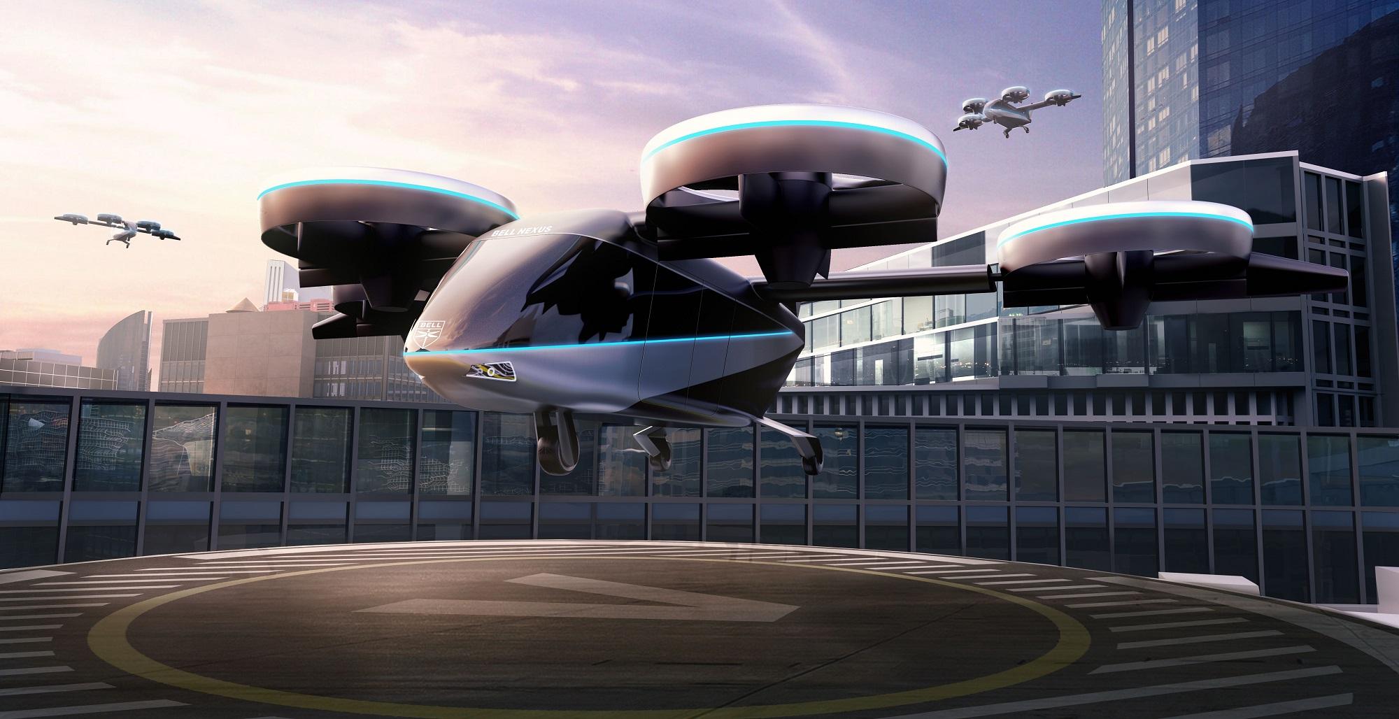 Projeção mostra táxi Voador Nexus 4ex em uma plataforma de pouso futurista